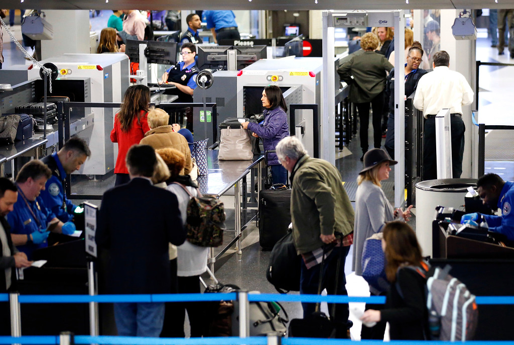 . Travelers line up at a security checkpoint area in Terminal 3 at O\'Hare International Airport in Chicago, Wednesday, Nov. 23, 2016. While driving remains the most popular form of transportation Thanksgiving travelers take, AAA expects just under 4 million people to fly to their holiday destinations. (AP Photo/Nam Y. Huh)