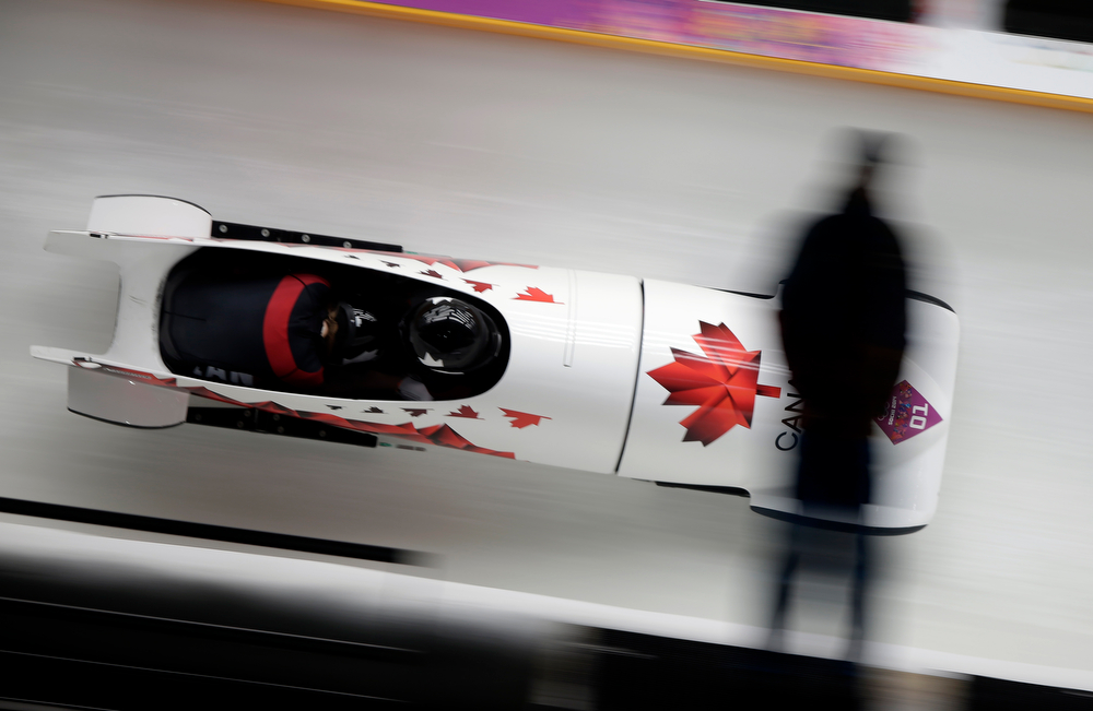 . The team from Canada CAN-1, piloted Kaillie Humphries with brakeman Heather Moyse, speed down the track during the women\'s two-man bobsled competition at the 2014 Winter Olympics, Tuesday, Feb. 18, 2014, in Krasnaya Polyana, Russia. (AP Photo/Michael Sohn)