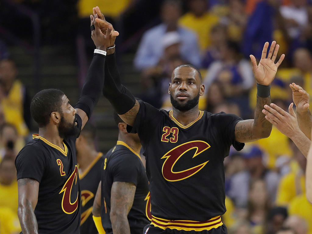 . Cleveland Cavaliers forward LeBron James (23) reacts after scoring Cleveland Cavaliers with guard Kyrie Irving (2) during the first half of Game 5 of basketball\'s NBA Finals in Oakland, Calif., Monday, June 12, 2017. (AP Photo/Marcio Jose Sanchez)