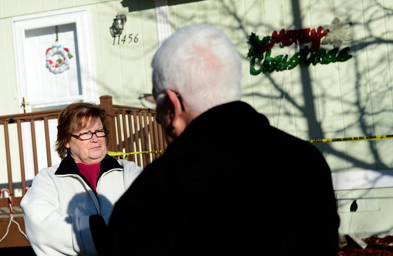 . Neighborhood residents Joyce and George Vibbert watch as Weld County Sheriffs investigators work the scene, Tuesday, Dec. 18, 2012, in Longmont. (Matthew Jonas/Times-Call)