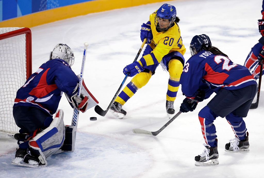 . Fanny Rask (20), of Sweden, shoots against South Korea\'s goalie Shin So-jung (31), of the combined Koreas team, during the third period of the preliminary round of the women\'s hockey game at the 2018 Winter Olympics in Gangneung, South Korea, Monday, Feb. 12, 2018. (AP Photo/Julio Cortez)