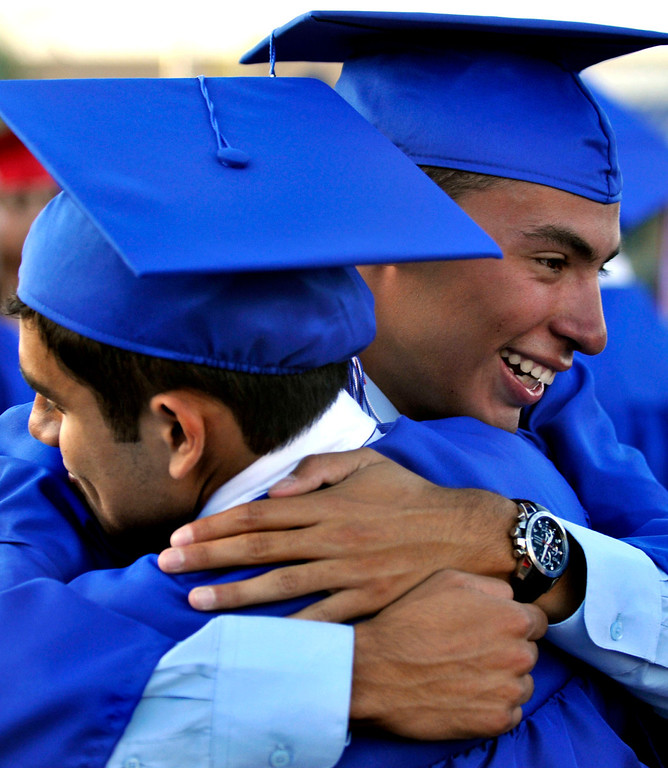 . Graduates David Heredia, 18,  left and Christian Garcia, 17, congratulate one another.  Los Altos High School\'s 53 Commencement Ceremonies held in the Patrick Mauch Memorial Stadium, Tuesday, May 21, 2013.  (Correspondent photo/Mike Mullen)