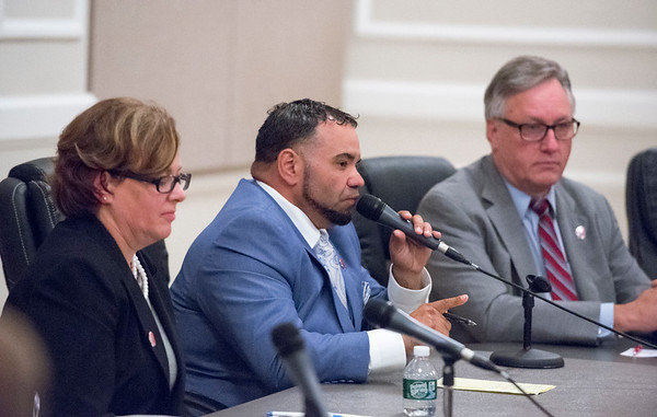10/07/19 Wesley Bunnell | StaffrrCandidates for public office met at the Board of Education on Monday night for an open forum for residents to ask questions. City Council member for the First District Scott Rosado, middle, answers a question from the audience.