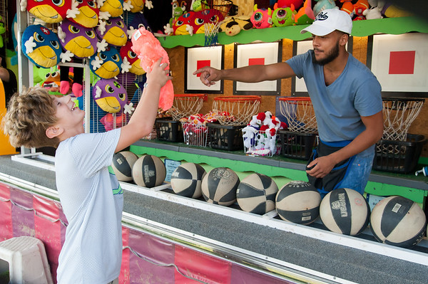 08/24/18 Wesley Bunnell | Staff Landin Boutot, age 11, wins a stuffed animal at the basketball game on the opening day of the Terryville Fair on Friday.