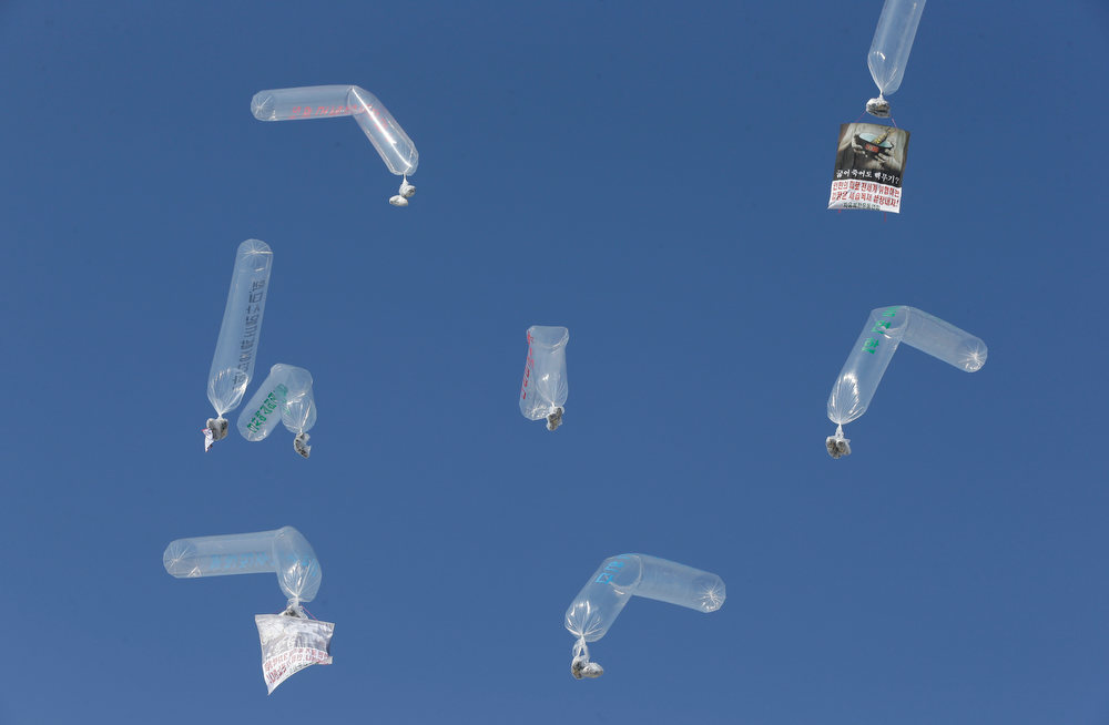 . Helium balloons carrying leaflets against North Korean leader Kim Jong Un and their dictatorship, are launched by North Korean defectors and South Korean activists during an anti-North Korea rally denouncing North Korea\'s third nuclear test at the Imjingak Pavilion near the border village of Panmunjom, in Paju, north of Seoul, South Korea, Saturday, Feb. 16, 2013. They flew the 200,000 propaganda leaflets across the border to denounce the nuclear test and late leader Kim Jong Il\'s birthday on Saturday. (AP Photo/Lee Jin-man)