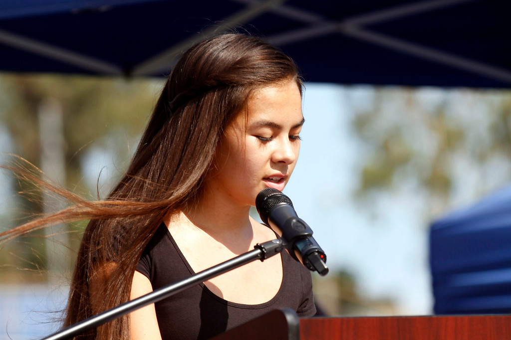 ". Cheyenne Heath-Warr, of the Crossroads Community Church, gives a reading, during the Vietnam Veterans Memorial ""The Wall That Heals\"" Closing Ceremony event, at La Habra High School, in La Habra, Sunday, July 14, 2013. (SGVN/Correspondent Photo by James Carbone)"