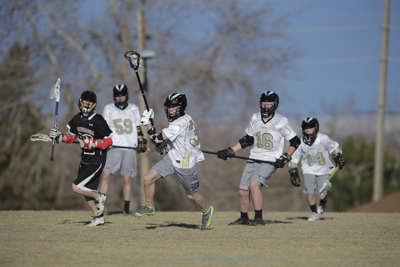 JPM0182-JPM0182-Jonathan first HS lacrosse game March 9th.jpg