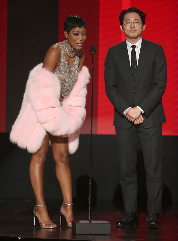 . Keke Palmer, left, and Steven Yuen present the award for favorite artist - rap/hip-hop at the American Music Awards at the Microsoft Theater on Sunday, Nov. 20, 2016, in Los Angeles. (Photo by Matt Sayles/Invision/AP)