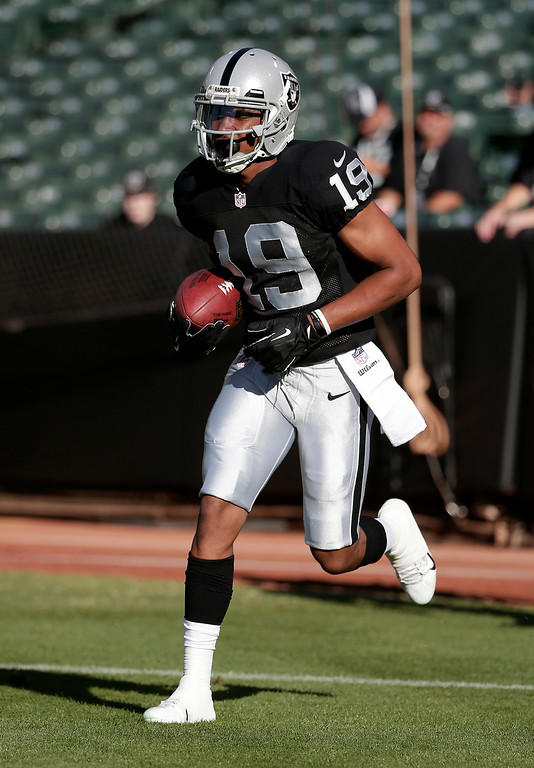 . Oakland Raiders wide receiver Mike Davis (19) warms up before an NFL preseason football game against the Detroit Lions in Oakland, Calif., Friday, Aug. 15, 2014. (AP Photo/Marcio Jose Sanchez)