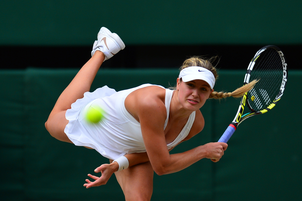 Description of . Canada\'s Eugenie Bouchard serves to Czech Republic\'s Petra Kvitova during their women\'s singles final match on day twelve of  the 2014 Wimbledon Championships at The All England Tennis Club in Wimbledon, southwest London, on July 5, 2014. (CARL COURT/AFP/Getty Images)