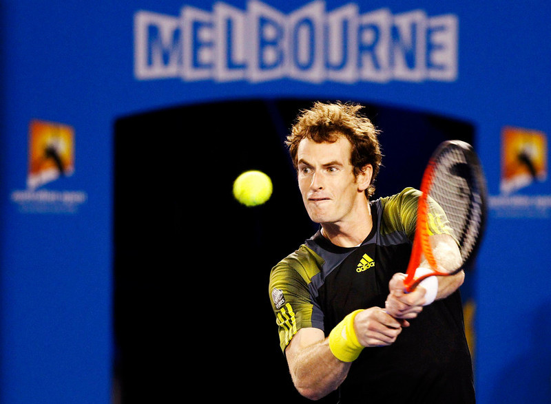 . Andy Murray of Britain hits a return to Novak Djokovic of Serbia during their men\'s singles final match at the Australian Open tennis tournament in Melbourne January 27, 2013. REUTERS/Daniel Munoz