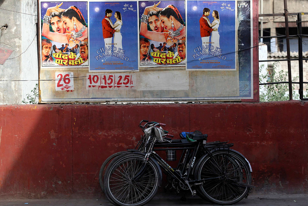 """. Posters for a low budget Hindi film are pasted onto the wall of a cinema in Meerut in the northern Indian state of Uttar Pradesh April 28, 2013. Indian cinema marks 100 years since Dhundiraj Govind Phalke\'s black-and-white silent film \""""Raja Harishchandra\"""" (King Harishchandra) held audiences spellbound at its first public screening on May 3, 1913, in Mumbai. Indian cinema, with its subset of Bollywood for Hindi-language films, is now a billion-dollar industry that makes more than a thousand films a year in several languages. It is worth 112.4 billion rupees (over $2 billion) and leads the world in terms of films produced and tickets sold. Picture taken April 28, 2013. REUTERS/Anindito Mukherjee"""