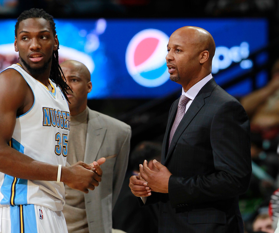 . Denver Nuggets forward Kenneth Faried, left, confers with head coach Brian Shaw during time out against the Portland Trail Blazers in the first quarter of an NBA basketball game in Denver, Tuesday, Feb. 25, 2014. (AP Photo/David Zalubowski)