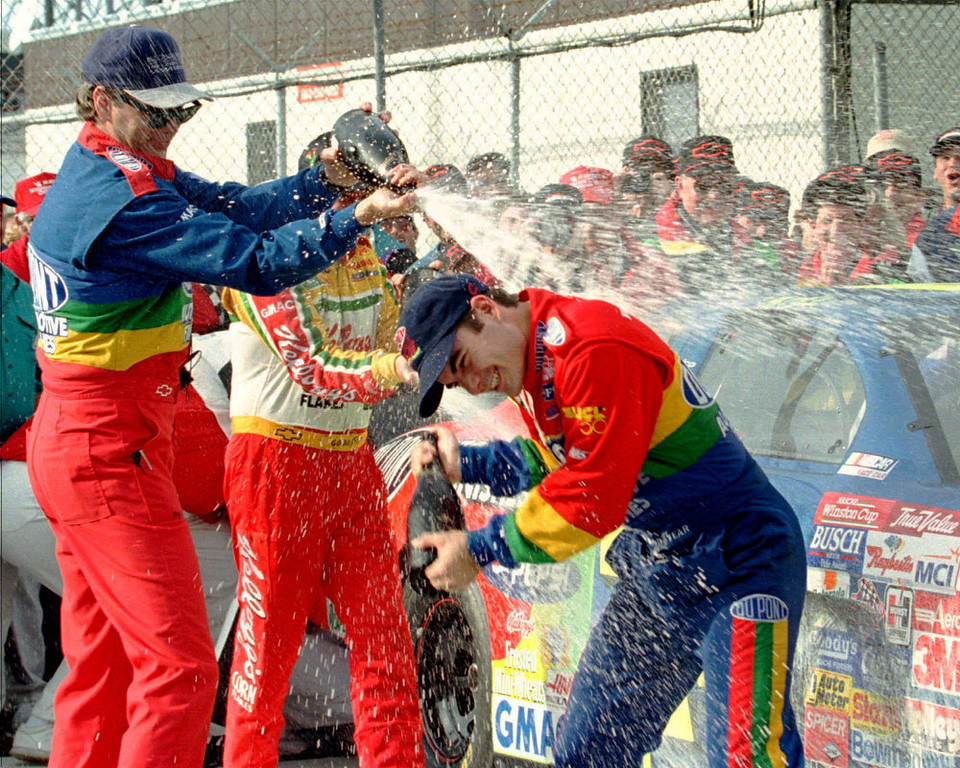 . Daytona 500 winner Jeff Gordon, from Pittsboro, Ind., right, is showered with champagne by DuPont Refinishes Chevrolet crew chief Ray Evernham, left, and Terry Labonte in Victory Lane Sunday afternoon Feb. 16, 1997 at Daytona International Speedway in Daytona Beach, Fla. (AP Photo/Terry Renna)