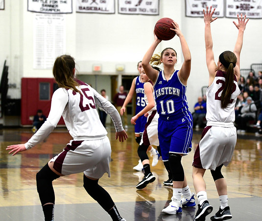 1/17/2019 Mike Orazzi | Staff Bristol Eastern's Meredith Forman (10) and Bristol Central's Kayla Beaulieu (22) during Thursday night's girls basketball game at BC.
