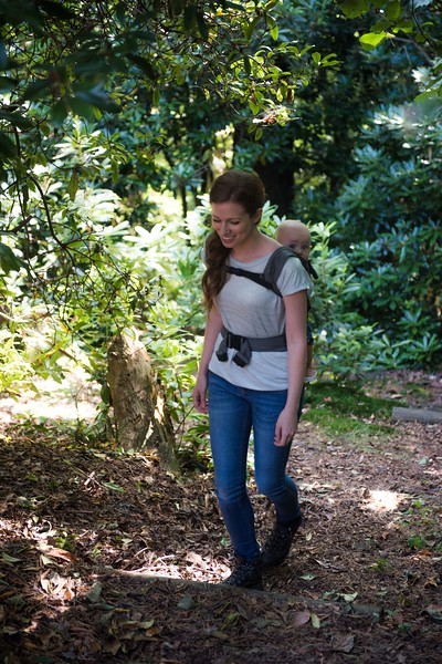 Izmi_Baby_Carrier_Mid_Grey_Lifestyle_Back_Carry_Mum_Walking_In_Woods_Front_View.jpg