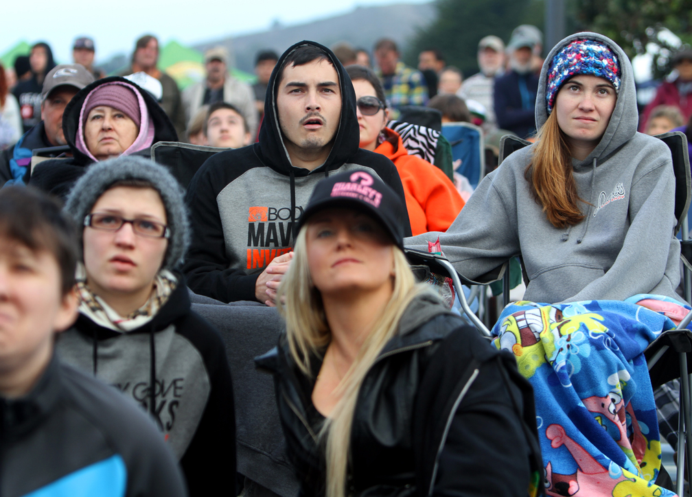 . Surfers and fans from across the Bay Area gathered by the masses in Half Moon Bay on Friday to watch the Mavericks Invitational surfing competition. (Kevin Johnson/Sentinel)