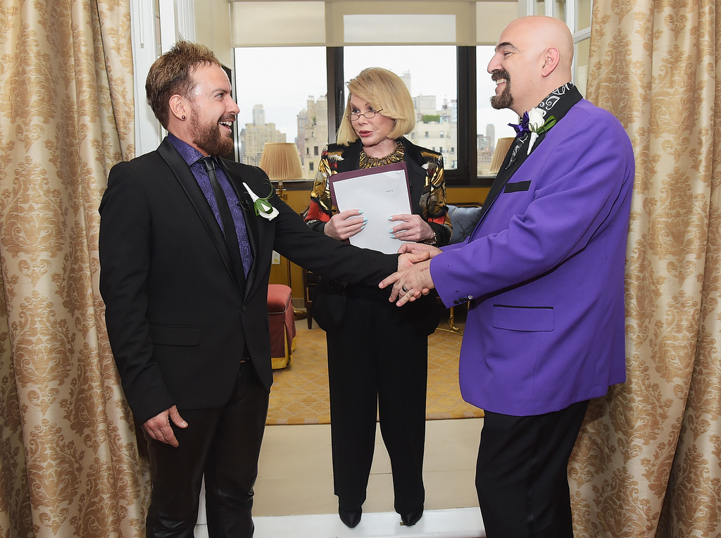 """. TV personality Joan Rivers officiates the gay wedding of William \""""Jed\"""" Ryan (L) and Joseph Aiello at the Plaza Athenee on August 15, 2014 in New York City.  (Photo by Michael Loccisano/Getty Images)"""