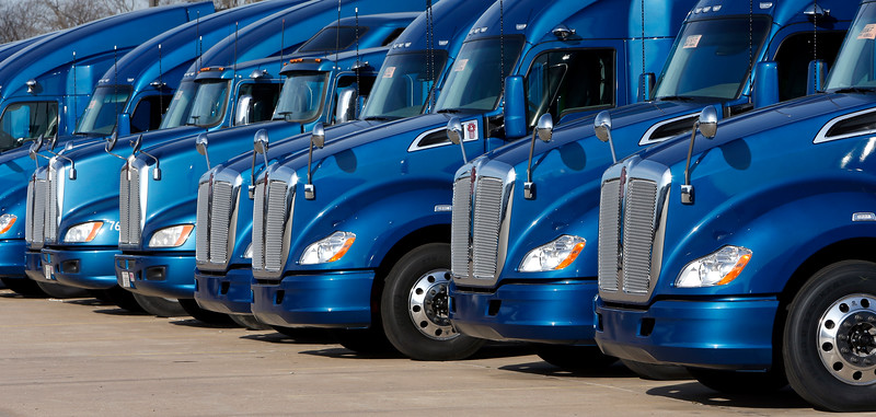 Tractor trailer trucks are lined up at the Melton Trucking office in Tulsa.