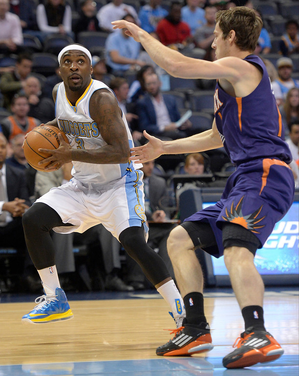 . Denver Nuggets point guard Ty Lawson (3) looks to pass as Phoenix Suns point guard Goran Dragic (1) defends on the play during the first quarter October 23, 2013 at Pepsi Center. (Photo By John Leyba/The Denver Post)