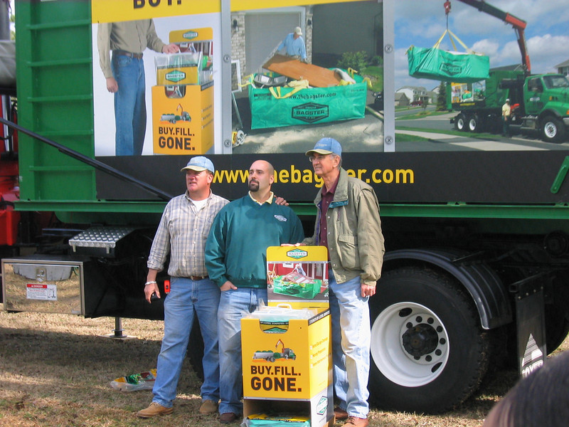 08 01 Mark Galey and Millard with rep from bagster.com donating debris removal