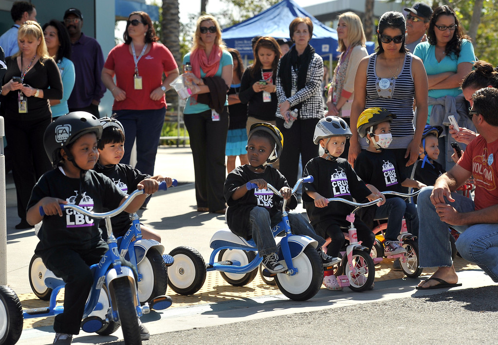 . 4/11/13 - Eager riders and their cheering sections line up just before the annual tricycle track to kick-off the Tour of Long Beach (TOLB) which happens May 11, 2013. Proceeds from the Tour of Long Beach benefit the patients and families at the Jonathan Jaques Children�s Cancer Center at Miller Children�s. Photo by Brittany Murray / Staff Photographer