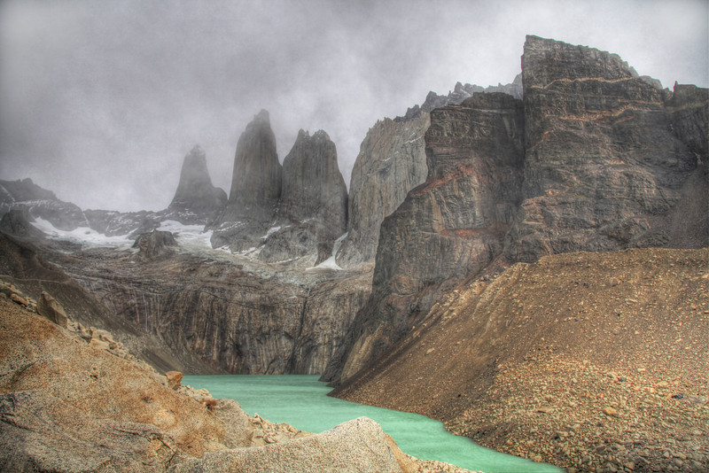 Torres del Paine under ominous skies. It was a 10km, 5 hour hike in driving mist to get to this vantage point. (HDR)