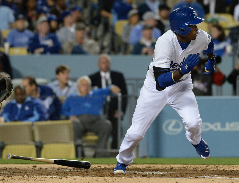 . Los Angeles Dodgers\' Dee Gordon watches his single in the second inning of a baseball game against the Philadelphia Phillies on Tuesday, April 22, 2013 in Los Angeles.   (Keith Birmingham/Pasadena Star-News)