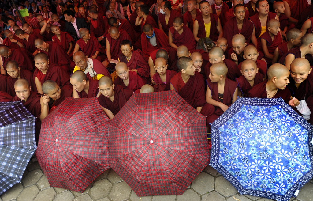 . Exiled Tibetan Buddhist monks watch festivities honouring the 78th birthday of their spiritual leader, His Holiness The Dalai Lama, as they observe his 78th birthday at Manag monastry in Kathmandu on July 6, 2013.  Thousands of Tibetans gathered to mark the Dalai Lama\'s 78th birthday on July 6, with the Nepalese government saying it would not tolerate anti-China activities on its soil.  PRAKASH MATHEMA/AFP/Getty Images