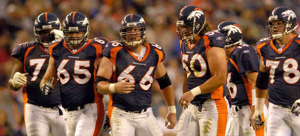 . L to R - #72 George Foster, #65 Cooper Carlisle, #66 Tom Nalen, #50 Ben Hamilton and #78 Matt Lepsis break the huddle in the 1st half of the game between the Denver Broncos and the SanFrancisco 49ers at Invesco Field at Mile High on Saturday August 20th, 2005 in Denver, Co. (DENVER POST PHOTO BY JOHN LEYBA)