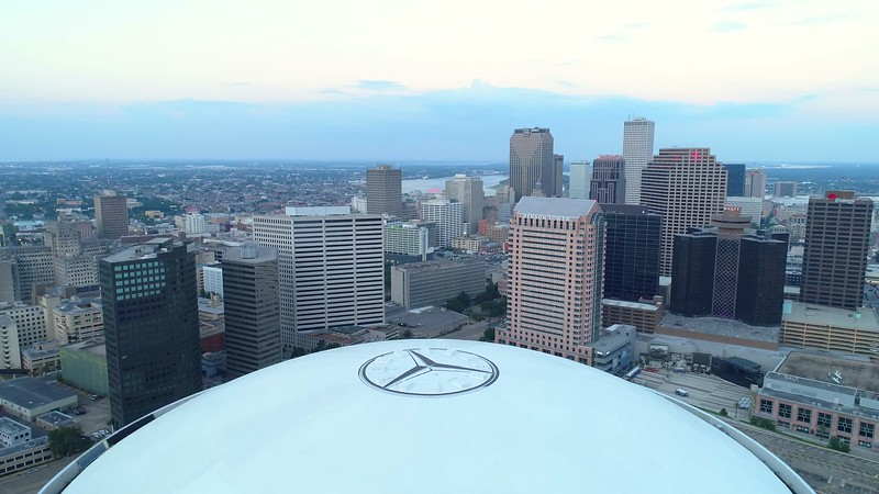 Aerial pull out shot Mercedes benz Superdome sports stadium 4k