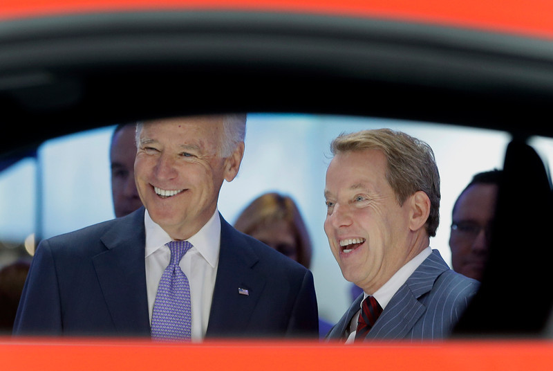 . Vice President Joe Biden and Ford Motor Co., Executive Chairman Bill Ford are seen through a Ford Mustang during a tour of the North American International Auto in Detroit, Thursday, Jan. 16, 2014. Biden said the U.S. auto industry\'s resurgence since the 2009 federal bailout provides a strong basis for a Motor City recovery.  (AP Photo/Carlos Osorio)