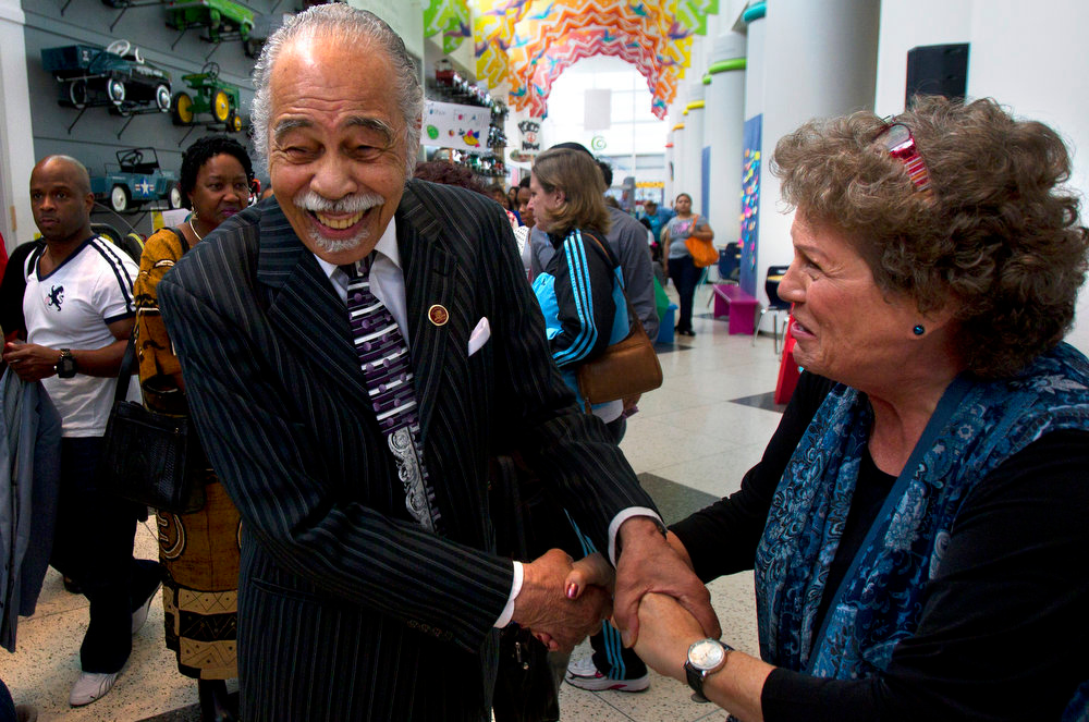 Description of . Dr. Thomas Freeman, center, is greeted by Marcy Bannor, right, at the Children's Museum of Houston, Monday, Jan. 21, 2013, in Houston.on Martin Luther King Day. Freeman, former teacher of Rev. Dr. King, Jr. and Rep. Barbara Jordan, received the Caryakid Award at the museum. (AP Photo/Houston Chronicle, Cody Duty)