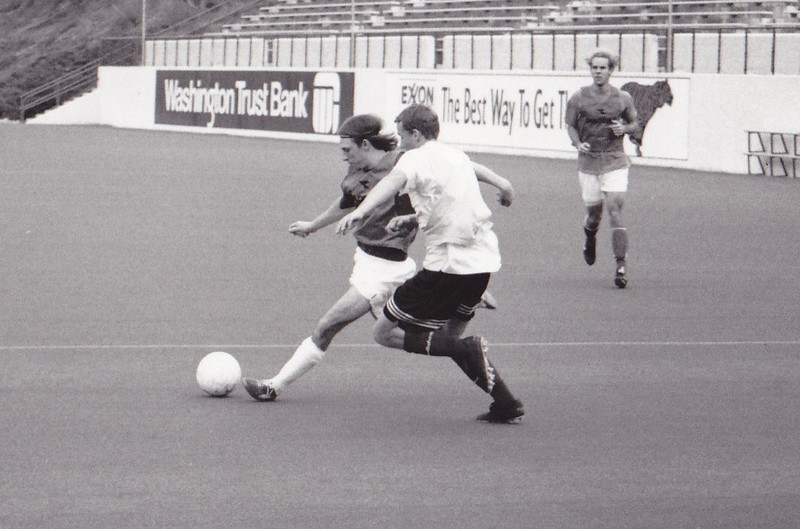 Zane Higgins, the star striker before Ching's arrival, was a speedy little player that despite being older than most, created havoc for defenses out on the flank. He is challenged by Kris Hollingshead with Matt Blasdell looking on.