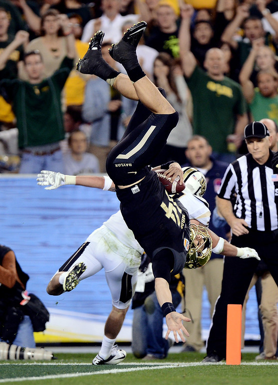 . Quarterback Bryce Petty #14 of the Baylor Bears scores a touchdown as defensive back Sean Maag #31 of the UCF Knights defends during the Tostitos Fiesta Bowl at University of Phoenix Stadium on January 1, 2014 in Glendale, Arizona.  (Photo by Jennifer Stewart/Getty Images)