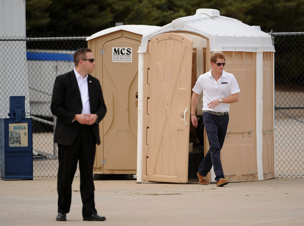 ". Even his royal highness needs to use the ""Loo\"".  Prince Harry takes a quick nature break before the medal ceremonies.  The fourth annual Warrior Games cycling event took started and finished at Falcon Stadium on the grounds of the Air Force Academy in Colorado Springs, CO on May 12, 2013.  HRH Prince Harry was on hand to start the race as well as to hand out medals at the finish line.   A total of 260 wounded, ill and injured service members and veterans came to compete in the week long games.  Members of the Army, Marine Corps, Navy/Coast Guard/Air Force. Special Operations and the British Armed Forces all took part in the competition.  Other events included in the Warrior Games are shooting, sitting volleyball, track & field and wheelchair basketball.  (Photo by Helen H. Richardson/The Denver Post)"