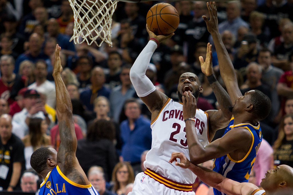 . LeBron James of the Cleveland Cavaliers shoots over Kevin Durant (right) and Andre Iguodala (left) of the Golden State Warriors during game 4 of the NBA Finals against the Golden State Warriors at the Quicken Loans Arena on June 10, 2017.  The Cavs defeated the Warriors 137-116.