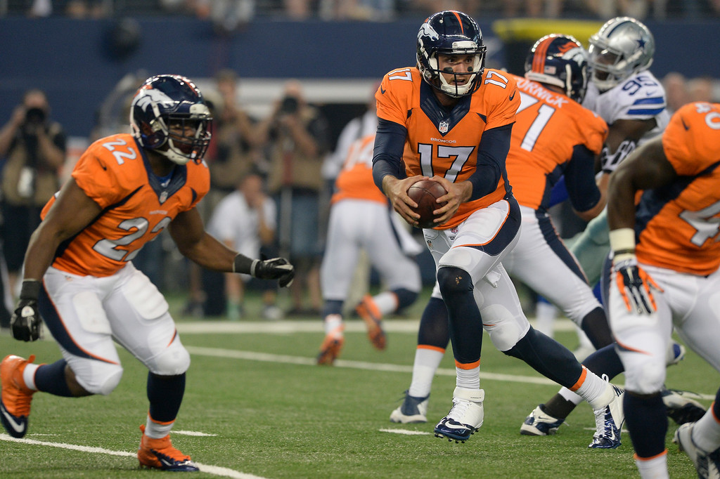 . ARLINGTON, TX - AUGUST 28: Denver Broncos quarterback Brock Osweiler (17) drops back to pass during the first quarter against the  Dallas Cowboys August 28, 2014 at AT&T Stadium. (Photo by John Leyba/The Denver Post)