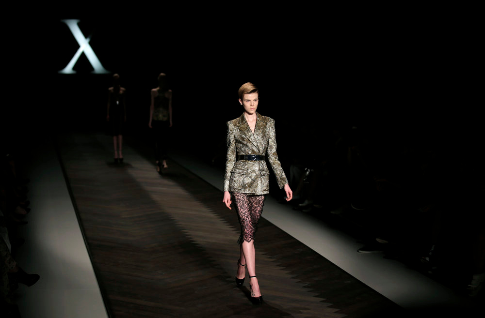 . A model wears the fashions of designers Camilla and Marc during their show at Fashion Week in Sydney, Australia, Monday, April 8, 2013. (AP Photo/Rick Rycroft)
