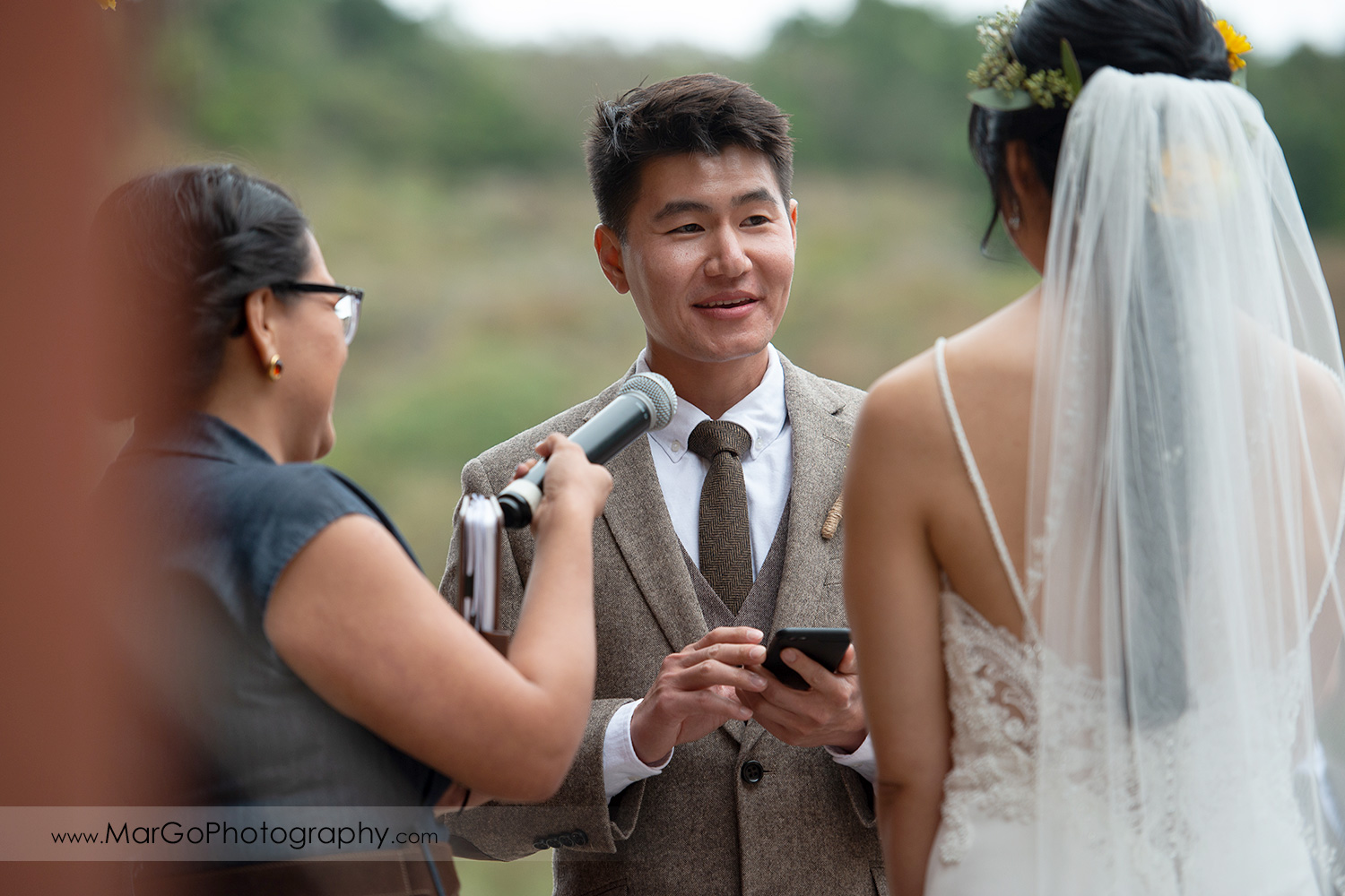 groom reading vows during wedding ceremony at Long Branch Saloon & Farms in Half Moon Bay