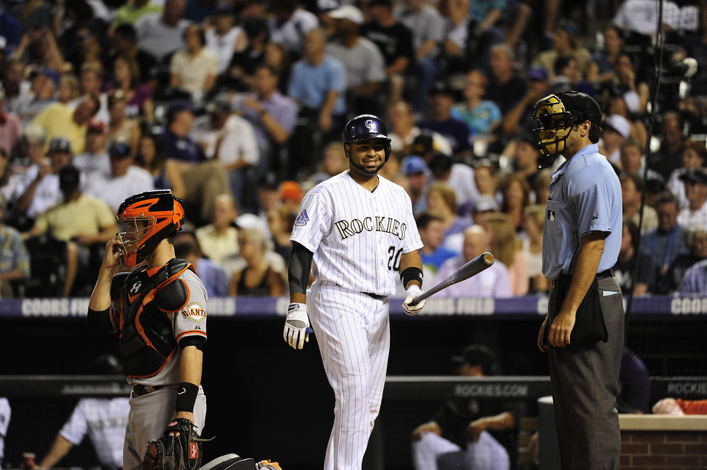 . DENVER - JUNE 28: Wilin Rosario, #20, of the Colorado Rockies smiles as he takes the mound during the seventh inning of a baseball game against the San Francisco Giants on June 28, 2013 at Coors Field. (Photo By Grant Hindsley / The Denver Post)