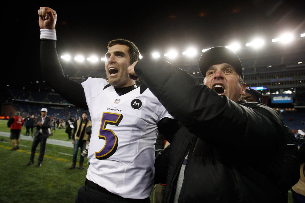 Description of . Head coach John Harbaugh and Joe Flacco #5 of the Baltimore Ravens celebrates after defeating the New England Patriots in the 2013 AFC Championship game at Gillette Stadium on January 20, 2013 in Foxboro, Massachusetts. The Baltimore Ravens defeated the New England Patriots 28-13.  (Photo by Jim Rogash/Getty Images)