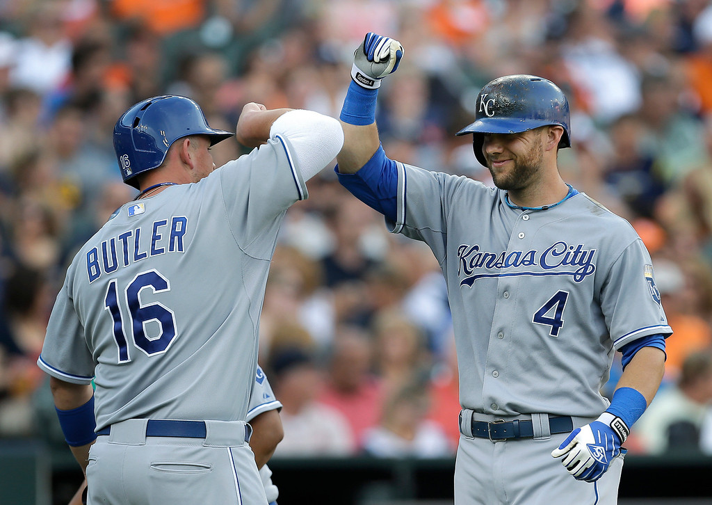 . Kansas City Royals\' Alex Gordon (4) celebrates his his two-run home run with Billy Butler (16) against the Detroit Tigers in the second inning of a baseball game in Detroit, Tuesday, June 17, 2014.  (AP Photo/Paul Sancya)