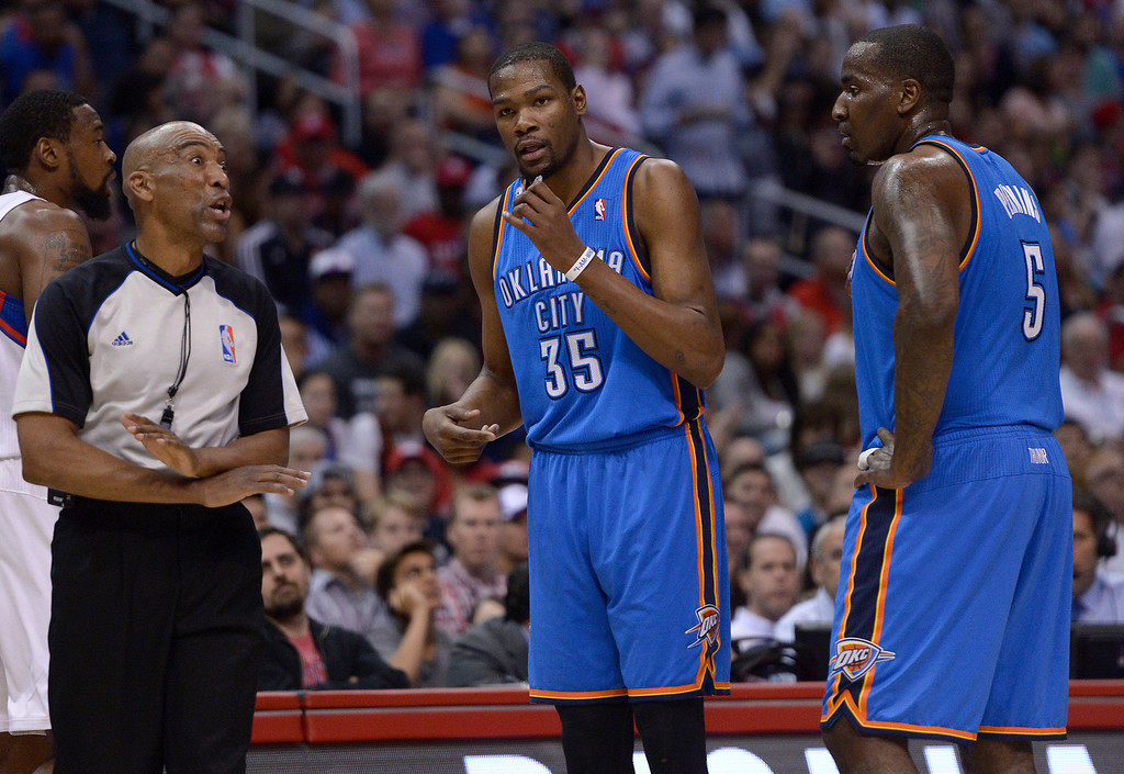 . The official rejects an argument by Thunder#35 Kevin Durant and Thunder#5 Kendrick Perkins after Perkins was called for a technical foul in the first half. The Los Angeles Clippers played the Oklahoma City Thunder in a regular season game at Staples Center in Los Angeles, CA. 4/9/2014(Photo by John McCoy / Los Angeles Daily News)