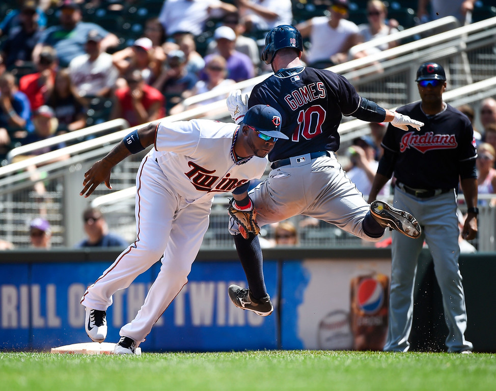 . Cleveland Indians\' Yan Gomes (10) is tagged out by Minnesota Twins first baseman Kennys Vargas during the fifth inning of a baseball game Sunday, July 17, 2016, in Minneapolis. Gomes was injured on this play and had to leave the game. (AP Photo/Craig Lassig)