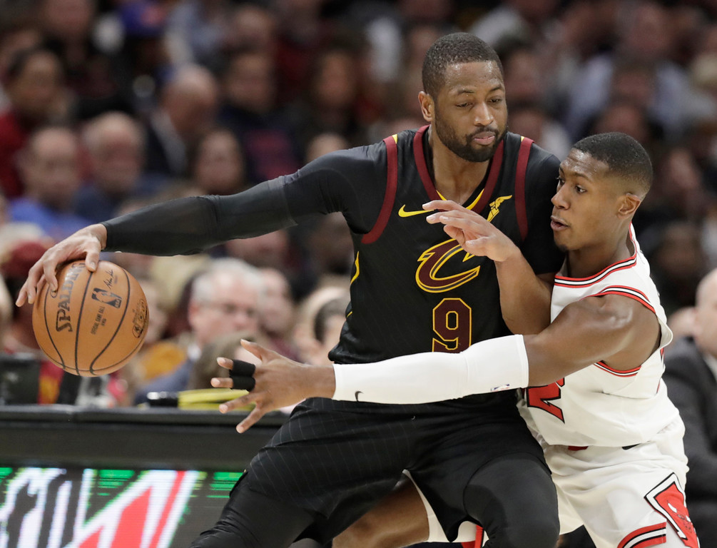 . Cleveland Cavaliers\' Dwyane Wade, left, works agianst Chicago Bulls\' Kris Dunn during the second half of an NBA basketball game Thursday, Dec. 21, 2017, in Cleveland. The Cavaliers won 115-112. (AP Photo/Tony Dejak)