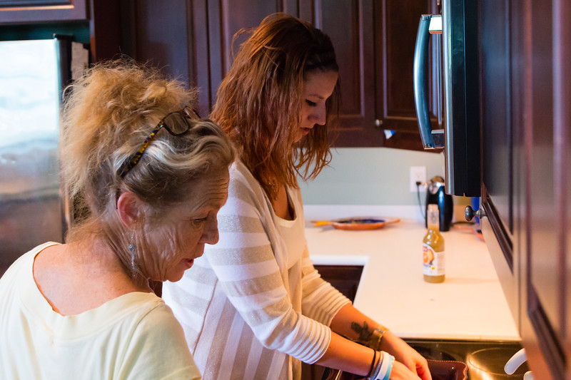 'House mom' Karen Altieri Sharp and Shelby Sparrow talk while Shelby prepares a dinner of pork chops and yellow rice for the residents of the All About Recovery younger women's sober home in Loxahatchee, Florida on Wednedsay, June 1, 2016. (Joseph Forzano / The Palm Beach Post)