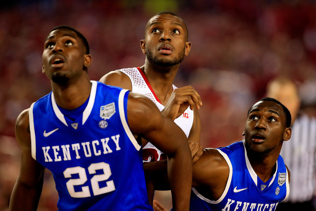 . ARLINGTON, TX - APRIL 05: Vitto Brown #30 of the Wisconsin Badgers is boxed out by Alex Poythress #22 and Dominique Hawkins #25 of the Kentucky Wildcats during the NCAA Men\'s Final Four Semifinal at AT&T Stadium on April 5, 2014 in Arlington, Texas.  (Photo by Jamie Squire/Getty Images)