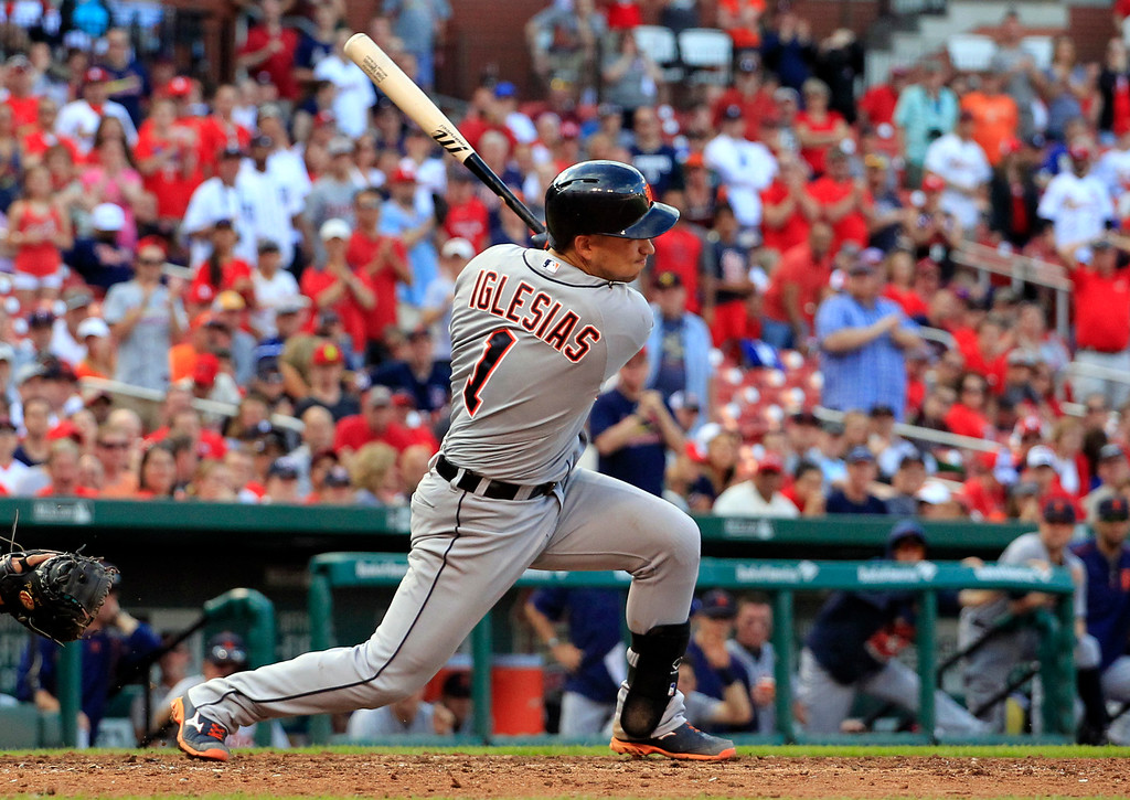 . Detroit Tigers\' Jose Iglesias follows through on an RBI-single during the 10th inning of a baseball game against the St. Louis Cardinals, Saturday, May 16, 2015, in St. Louis. The Tigers won 4-3. (AP Photo/Jeff Roberson)