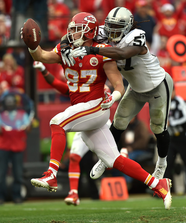 . KANSAS CITY, MO - DECEMBER 14:   Richard Gordon #89 of the Kansas City Chiefs scores a touchdown against  Ray-Ray Armstrong #57 of the Oakland Raiders in the third quarter at Arrowhead Stadium on December 14, 2014 in Kansas City, Missouri.  (Photo by Peter Aiken/Getty Images)